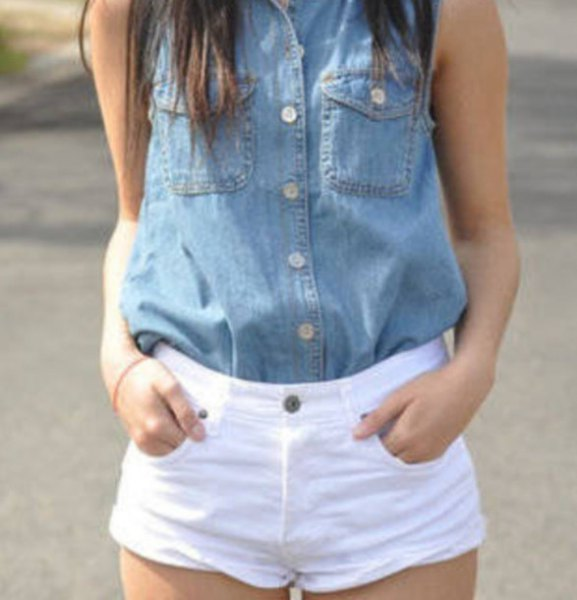 blue sleeveless chambray button up shirt with white shorts