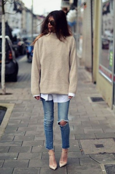 blush pink knit sweater with white button up shirt and ripped knee jeans