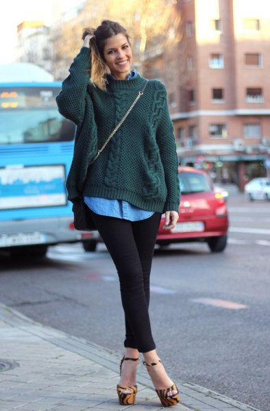 dark green cable knit sweater with blue chambray button up shirt