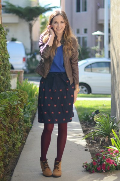 grey bomber jacket with royal blue tee and knee length skirt