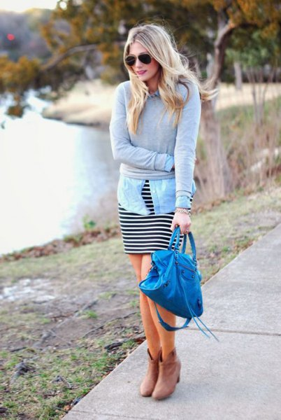 grey sweater with light blue chambray shirt and black and white striped dress