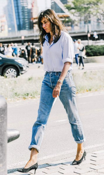 light blue button up tucked shirt with cuffed mom jeans and black heels
