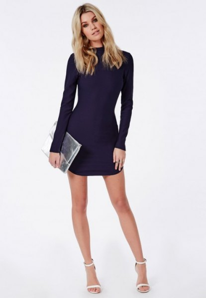 long sleeve navy blue lace mini bodycon dress with silver metallic clutch bag