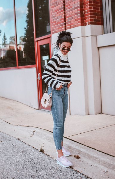 mock neck sweater with cropped skinny jeans and white sneakers