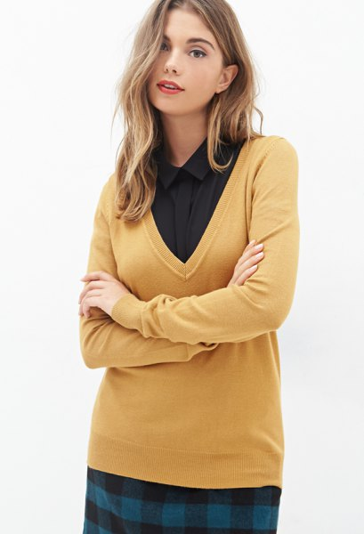 mustard yellow v neck sweater with black button up shirt