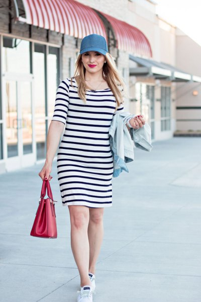 navy blue and white sheath dress with baseball denim cap