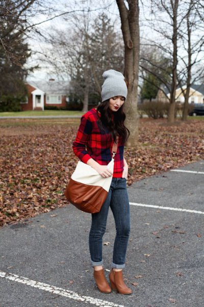 red and black plaid flannel shirt with brown heeled ankle boots