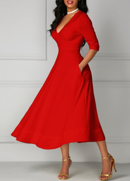 red half sleeve v neck fit and flare midi dress with gold heels