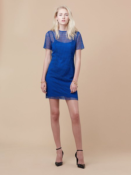 semi sheer blue mini sheath dress with black ankle strap pointed toe heels