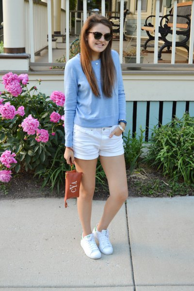 sky blue pullover sweater with white mini denim shorts and sneakers