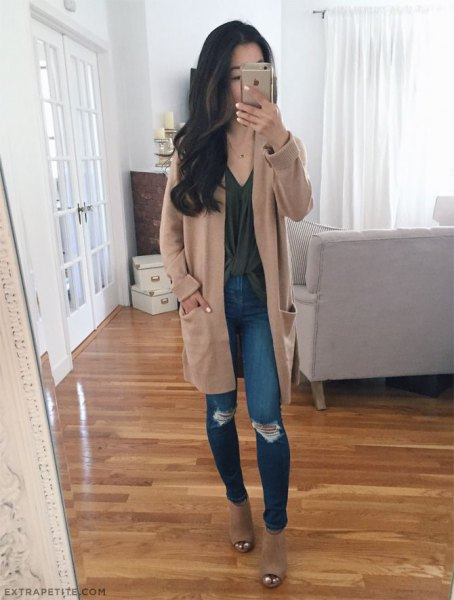 tan longline sweater cardigan with ripped knee blue skinny jeans