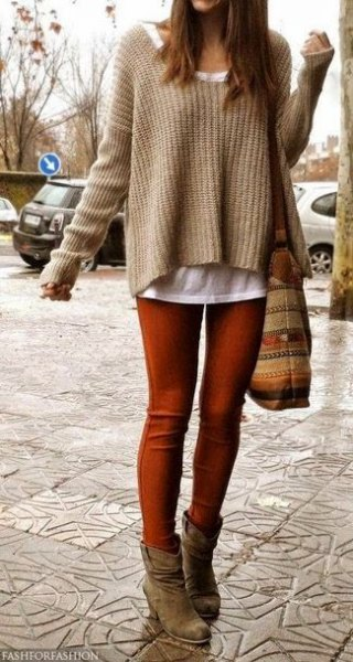 tan sweater with white tee and green skinny jeans