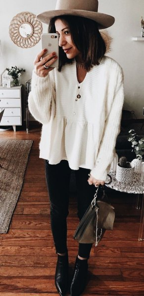 v neck sweater with blush pink hat and black jeans