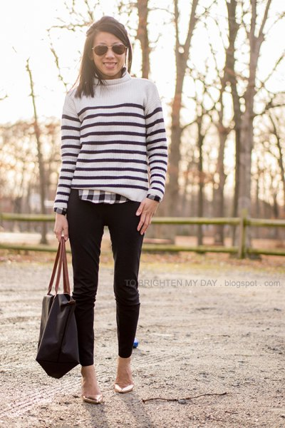 white and black sweater over checkered shirt