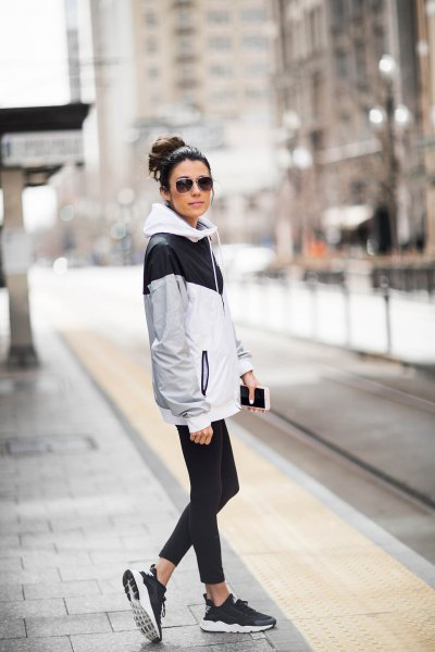 white and grey oversized windbreaker with running tights