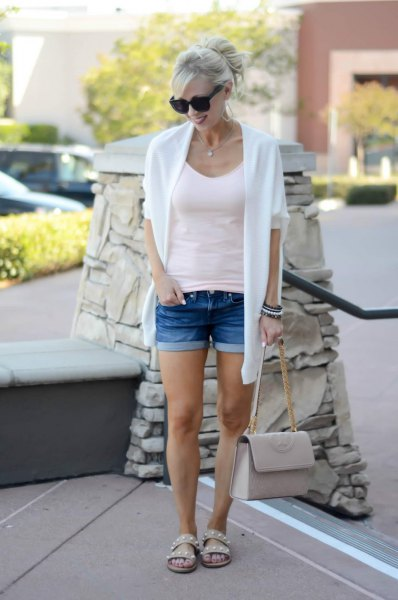 white cardigan sweater with scoop neck form fitting tank top and shorts