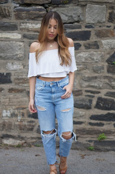 white cropped off the shoulder blouse with ripped knee jeans
