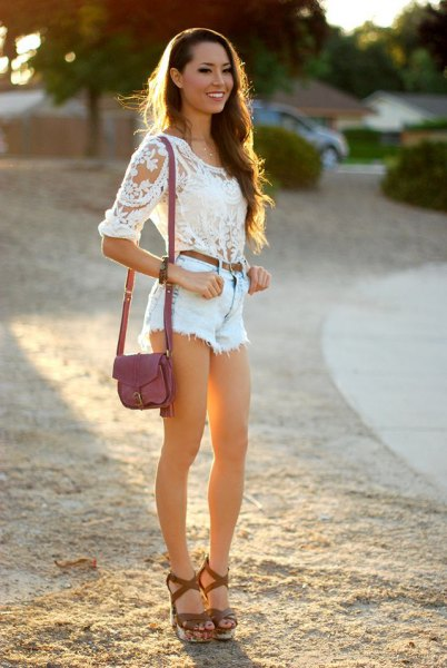 white lace blouse with light blue jean shorts and heeled sandals