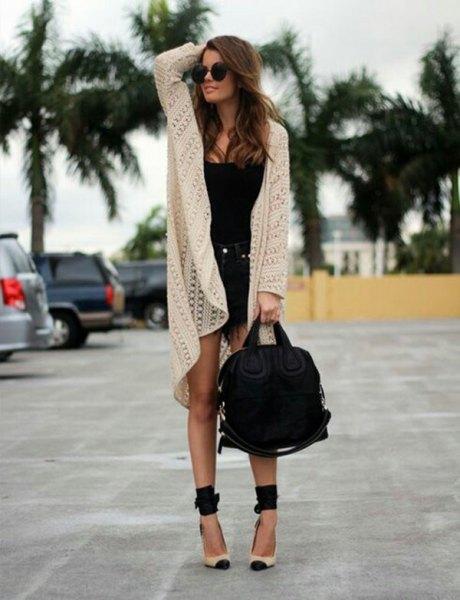 white long cardigan with black mini fringe denim shorts