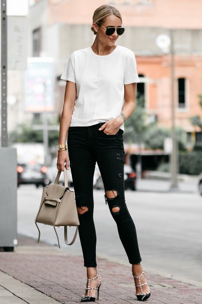 white t shirt with black skinny ripped jeans and strappy heels