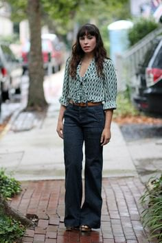 black and grey printed button up shirt with dark blue jeans