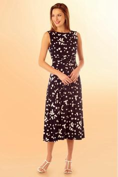black and white polka dot mid length dress with open toe heels