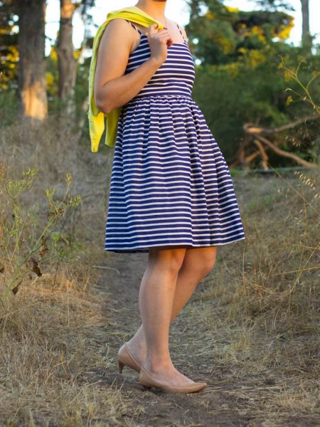 black and white striped fit and flare mini dress with mustard yellow cardigan