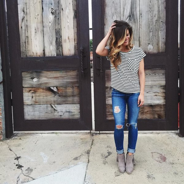 black and white striped short sleeve tee with blue ripped jeans