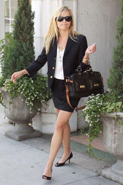 black blazer with mini skirt and leather handbag