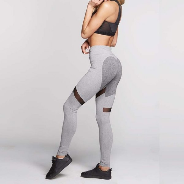 black crop top with light grey sport leggings and sneakers