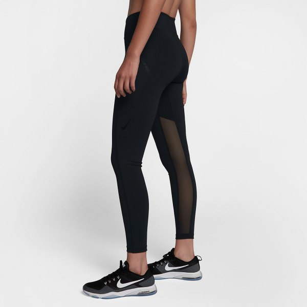 black crop top with matching semi sheer high waisted leggings and running shoes