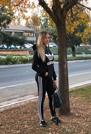 black hoodie with running leggings and sneakers