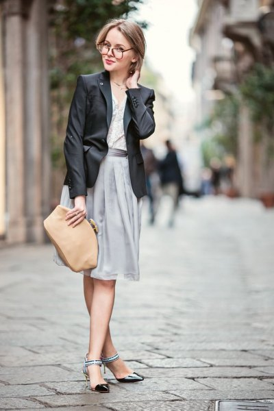 black leather jacket with grey knee length skirt