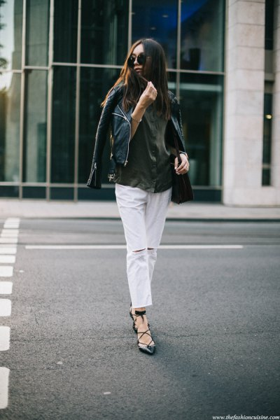 black leather moto jacket with white ripped cropped jeans