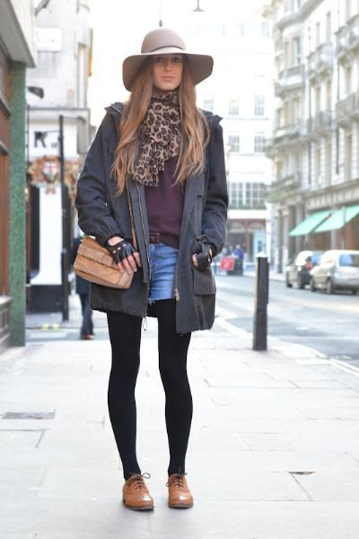 black long blazer with blue denim mini shorts and brown leather buck shoes
