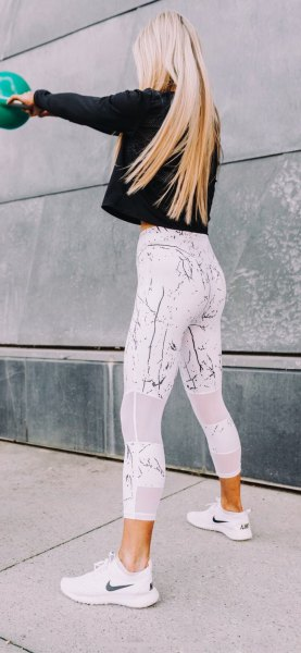 black long sleeve tee with white printed high waisted gym leggings