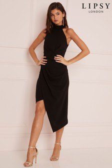 black low back halter top midi wrap dress with silver open toe heels