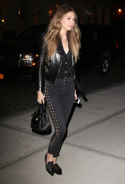 black moto jacket with button up shirt and lace up high rise pants