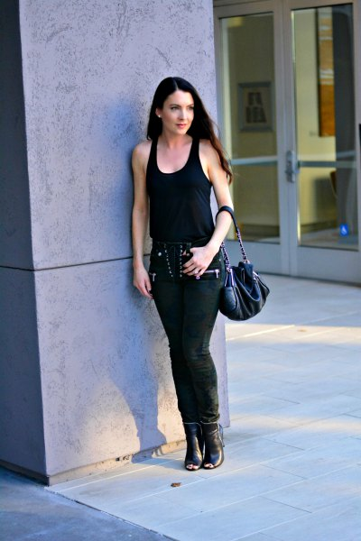 black scoop neck tank top with lace up slim fit pants and open toe boots