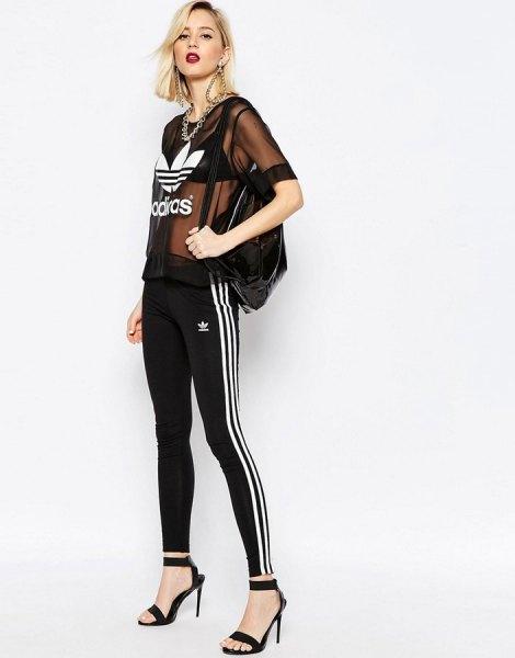 black semi sheer top with adidas leggings and heels