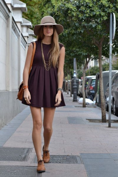 black sleeveless fit and flare mini pleated dress with brown oxford shoes