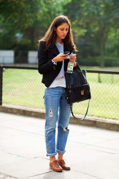 black slim fit blazer with cuffed boyfriend jeans and brown leather dress shoes
