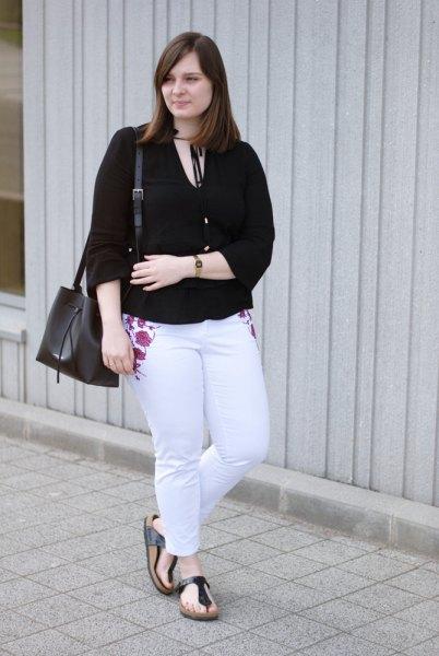 black v neck blouse with light blue embroidered slim fit jeans