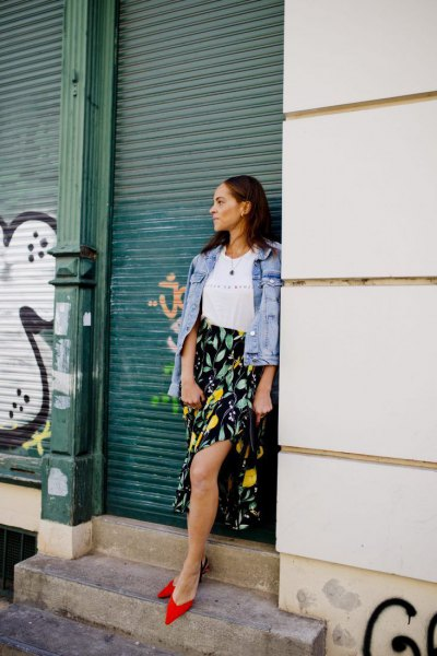 blue denim jacket with black and yellow printed side slit maxi skirt