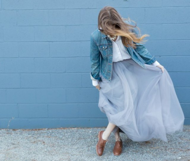 blue denim jacket with white button up shirt and light blue tulle maxi skirt