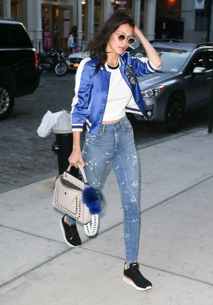 blue shiny bomber jacket with white cropped t shirt