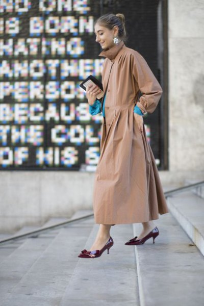 blush maxi coat with black kitten heel pumps
