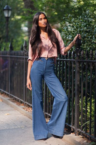 blush pink cropped button up shirt with blue flared jeans