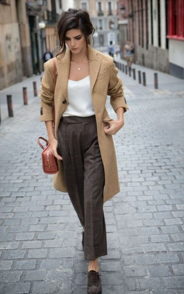 camel longline wool coat with white silk top and grey wide leg cropped pants