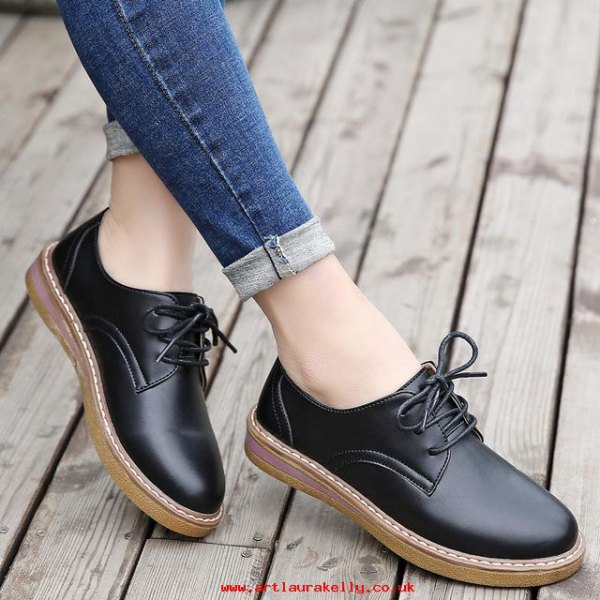 dark blue cuffed skinny jeans with black leather oxford dress shoes